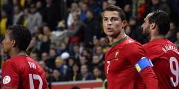 JONATHAN NACKSTRAND / AFP Penyerang Portugal Cristiano Ronaldo merayakan gol ke gawang Swedia dalam leg kedua play-off