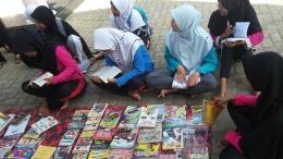 Anak- anak memperlihatkan minat baca yang tinggi (foto; dok pri)