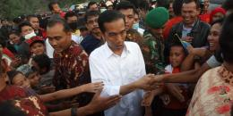 Presiden Joko Widodo saat blusukan di pinggiran Jakarta. Kompas.com