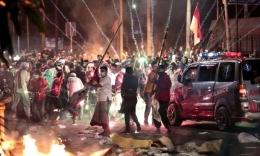 Kerusuhan 22 Mei [Foto: Dita Alangkara/AP]