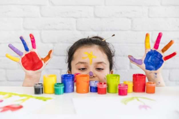 https://www.freepik.com/free-photo/girl-looking-multicolored-paint-bottles-white-desk-with-her-painted-palms_4118158.htm#page=2&query=children&positio