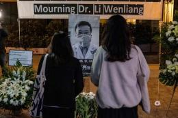 Mourners at a vigil for Dr. Li Wenliang on Friday.Credit...Lam Yik Fei for The New York Times