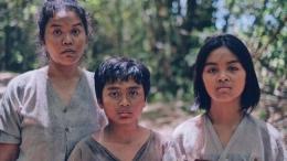 Ibu dan kedua anaknya yang ketamuan (sumber gambar: CNN Indonesia)