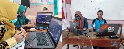 Mahasiswa KKN membantu guru-guru yang kesulitan dalam proses pembelajaran daring via Google Meet di SMP Negeri 2 Cilacap (dokrpi)