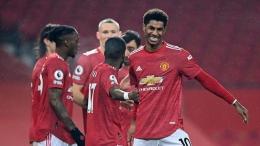 Beginilah cara merayakan kemenangan, penuh senyum (Foto: Getty Images/Laurence Griffiths)
