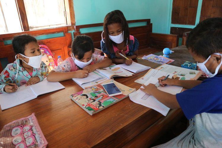Hari pendidikan nasional di masa pandemi dapat menjadi cermin bagi kita untuk mengevaluasi gerakan Merdeka Belajar   Ilustrasi oleh Moh. Syafii via Kompas.com
