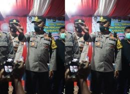 Kapolres Musi Rawas Utara AKBP Eko Sumaryanto mengoordinasikan anggota yang bertugas di lapangan dari pos penyekatan, agar penanganan pelarangan mudik serta pencegahan penyebaran Covid-19 efektif. Foto: mada mahfud