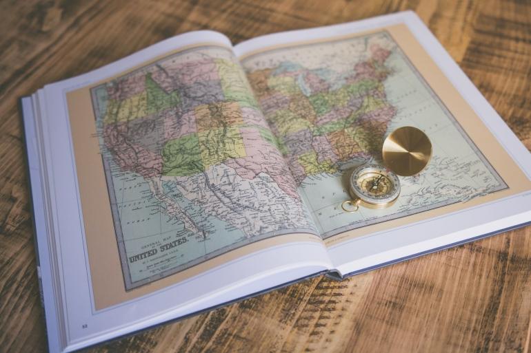 Ilustrasi peta dalam atlas (Photo by Chris Lawton on Unsplash)