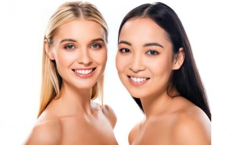 Gambar wanita Eropa dan Asia yang sedang tersenyum (dok: lightfieldstudios.net)