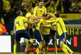 Pemain Swedia tampil dominan dengan warna cemburu. Bola Skor.com