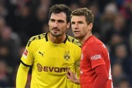 Dua pemain senior Jerman, Thomas Muller dan Mats Hummels (Foto AFP/Christof Stache via Kompas.com)