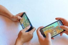 Ilustrasi anak bermain game online  Sumber: Shutterstock via Kompas.com