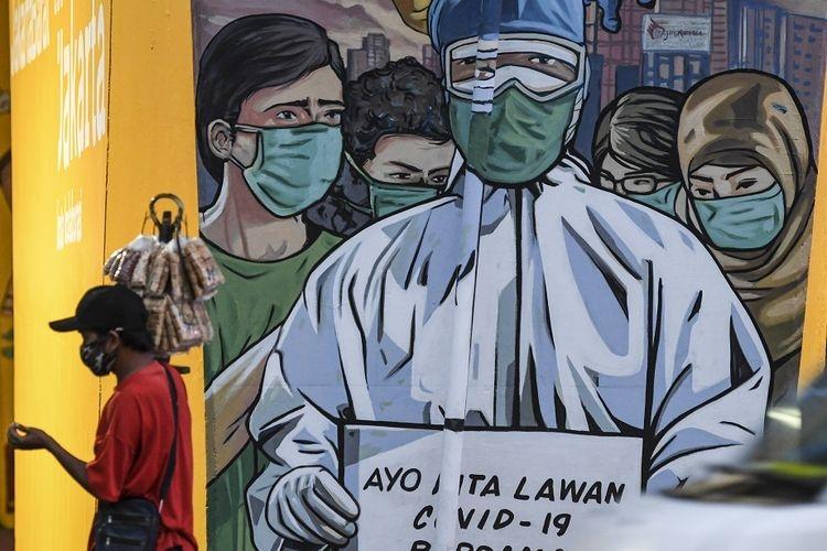 ilustrasi lawan corona. (sumber: ANTARA FOTO/M RISYAL HIDAYAT via kompas.com)