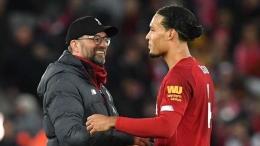 Juergen Klopp dan Virgil van Dijk (Foto Liverpoolfc.com)