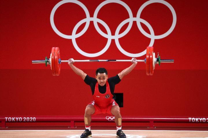 Eko Yuli Irawan saat berlaga di Olimpiade Tokyo. Eko berhasil meraih medali perak/Foto: REUTERS/Edgard Garrido