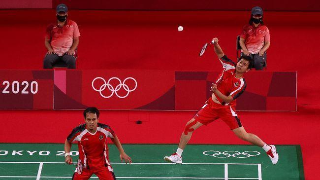 Ganda putra Indonesia, Mohammad Ahsan/Hendra Setiawan meraih kemenangan di laga perdana Olimpiade Tokyo 2020.(REUTERS/LEONHARD FOEGER)