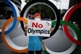Tokyo 2020 sempat didemo untuk dibatalkan. Sumber: Reuters / www.japantimes.co.jp