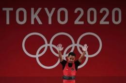 Eko Yuli Irawan meraih medali perak di Olimpiade Tokyo 2020 (foto:kompas.com/sigidkurniawan)