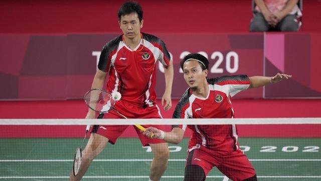 Hendra Setiawan dan Mohammad Ahsan berhasil melaju ke semifnal Olimpiade Tokyo 2020. Gambar: bola.com