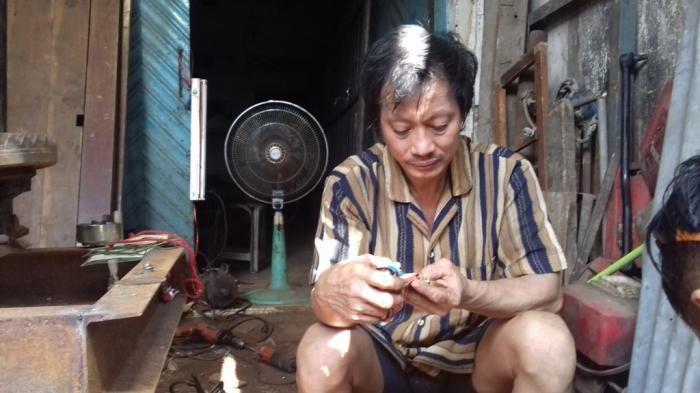 Denny Thios, Atlet Angkat Besi yang Kini Mengurusi Besi Tua (tribunnews.com)