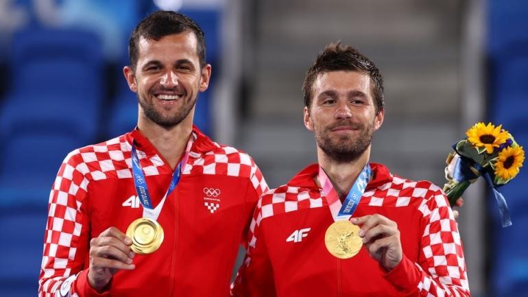 Mate Pavic dan Nikola Mektic, pemenang cabang tenis ganda putra Olimpiade Tokyo 2020 dari Kroasia (Reuters)