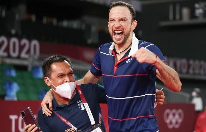 Kevin Cordon dan pelatihnya Muamar Khadafi (indosport.com)