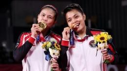 Greysia Polii dan pasangannya Apriyani Rahayu merebut medali emas bulutangkis ganda putri Olimpiade 2020.Foto:Lintao Zhang/Getty Images via detik.com