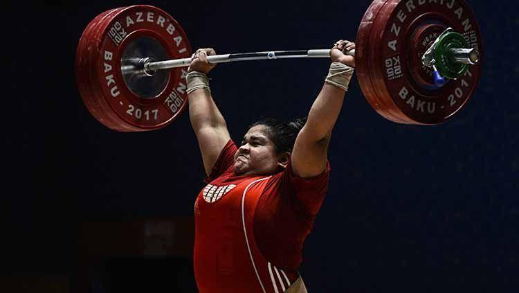 Nurul Akmal, atlet angkat besi wanita kelas berat asal Aceh yang mewakili Indonesia di ajang Olimpiade Tokyo 2020. (Sumber ilustrasi: indosport.com)