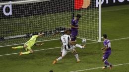 Gol Asensio menutup kemenangan Real Madrid atas Juventus di Final Liga Champions 2017. Sumber: Reuters/Phil Noble