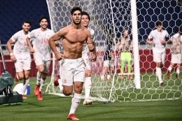 Selebrasi Asensio saat mencetak gol ke gawang Jepang pada pertandingan semifinal Olimpiade Tokyo 2020. Sumber: AFP/ANNE-CHRISTINE POUJOUL