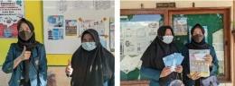 Gambar 3. Penempelan infografis di sekolah Nagari Koto Baru (dokpri)