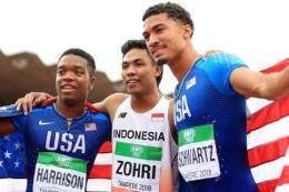 Zohri berpose bersama dua atlet Amerika, Schwartz dan Harrison setelah meraih kemenangan di Kejuaraan Atletik Junior 2018 (sumber ilustrasi: bbc.com)
