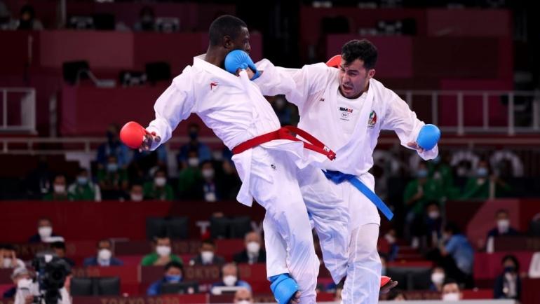 Tareg Hamedi (Merah) Ketika Berhadapan dengan Sajad Ganjzadeh (Biru) di Partai Final Kumite +75kg - Sumber : olympics.com