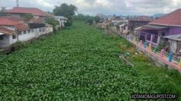 Sungai Tondano dan Eceng Gondok (Foto: kotamobagupost.com, 2019)