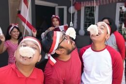 Ilustrasi rayakan hari kemerdekaan dengan adakan lomba makan kerupuk di rumah. Sumber: Shutterstock via Kompas.com