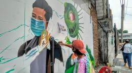 Mural protokol kesehatan di Medan dok. suara.com/Muhlis