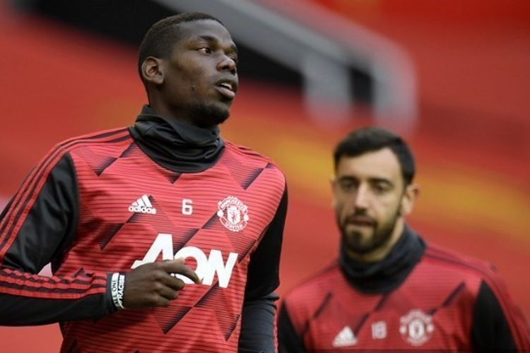 Dua gelandang Manchester United, Paul Pogba dan Bruno Fernandes.   Sumber: PETER POWELL/POOL/AFP via Kompas.com