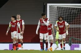 Ekspresi pemain Arsenal saat bermain imbang lawan Slavia Praha di leg pertama perempat final Liga Europa 2020-2021 (AFP/IAN KINGTON/via Kompas.com)