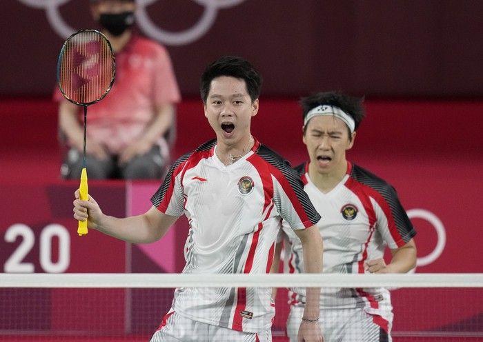 Kevin Sanjaya dan Marcus Gideon saat tampil di Olimpiade 2020. Rumor yang beredar, mereka bakal dipisah seiring kegagalan didi Olimpiade   Foto: AP