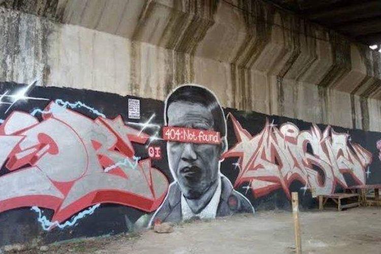 Mural mirip wajah Jokowi di kolong jembatan kereta bandara Soetta (Dok. NN/Istimewa)