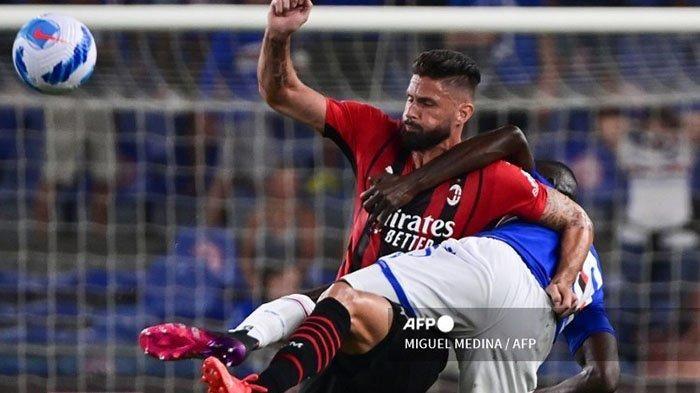Dengan pengalamannya, Olivier Giroud akan diandalkan AC Milan di Liga Champions 2021/22. Milan berada di grup berat/Foto: AFP/Miguel Medina
