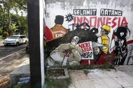Mural karya Serikat Mural Surabaya di kawasan Jalan Ngagel, Surabaya, Jawa Timur Sumber:IDXchannel.com