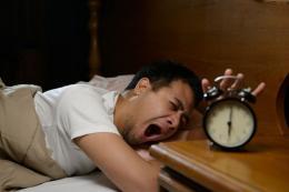 Ilustrasi seseorang yang malas bangun tidur. Sumber: Kompas.com