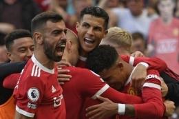 Cristiano Ronaldo merayakan gol keduanya dalam debutnya bersama Manchester United di Liga Inggris.Foto : Oli Scarff/AFP via kompas.com