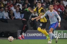 Cristiano Ronaldo pencetak satu-satunya gol ke gawang Young Boys dalam laga fase grup Liga Champions (Foto AFP/Sebastien Bozon via Kompas.com)