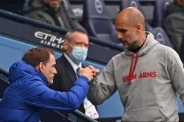 Thomas Tuchel (kiri) dan Pep Guardiola (Kanan) akan kembali bersua pekan ini. Foto: AFP/Shaun Botterill via Kompas.com