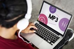 Ilustrasi MP3. Teknologi kompresi file audio. (sumber: SHUTTERSTOCK/Rawpixel.com via kompas.com)
