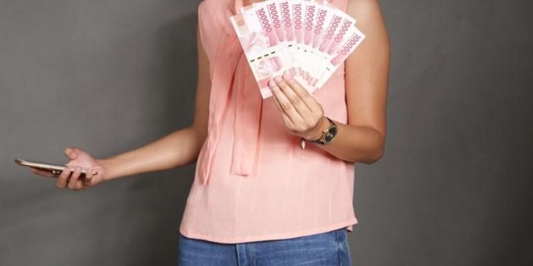Ilustrasi pinjam uang (Shutterstock/Melimey)