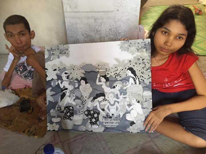 Agus dan Windari bersama lukisannya.