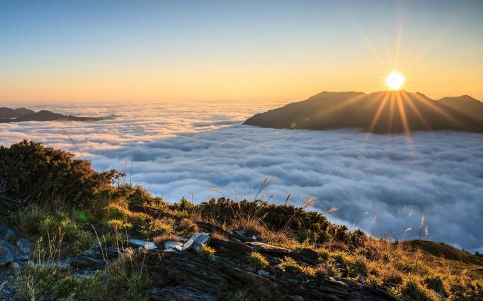 sunrise-above-the-clouds-5c485744c112fe70eb5faf66 - Witness the Exotic Golden Sunrise of Bromo - paket wisata
